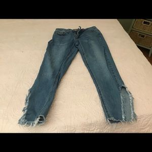 Tattered look blue jeans